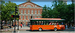 old town trolley passing by faneuil hall